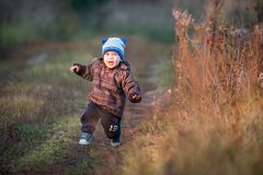 cute child walking outdoors royalty free stock photos