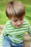 Cute child wearing green shirt in the garden Stock Photo