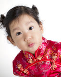 Cute child wearing red Chinese suit Royalty Free Stock Images
