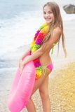 Cute child wearing swimsuit walking at beach in Royalty Free Stock Images