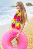 Cute child is wearing swimsuit walking at beach in Royalty Free Stock Images