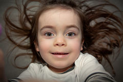 Cute child with wild hairs Royalty Free Stock Photo