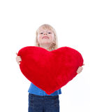 Cute Child With Red Heart Look At Camera Royalty Free Stock Photos