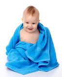 Cute child wrapped in blue towel Stock Images