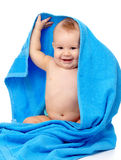 Cute child wrapped in blue towel Stock Photos