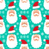 Cute childish winter seamless pattern with hand drawn Christmas elements as Santa Claus face and snowflakes background Stock Images