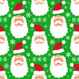 Cute childish winter seamless pattern with hand drawn Christmas elements as Santa Claus face and snowflakes background Royalty Free Stock Photography