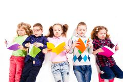 The cute children with books stock photos