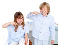 Cute children brushing their teeth stock photos