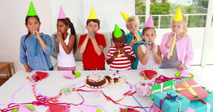 Cute children celebrating a birthday together Stock Image