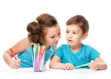 Cute children is drawing on white paper royalty free stock image