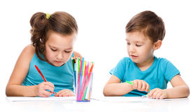 Cute children is drawing on white paper stock image