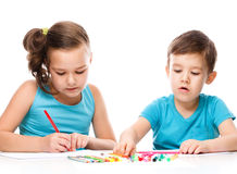 Cute children is drawing on white paper stock photos