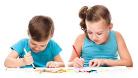 Cute children is drawing on white paper stock photo