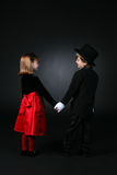 Cute children in dressy clothes holding hands Royalty Free Stock Images