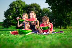 Cute children eating watermelon Royalty Free Stock Image