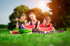 Cute children eating watermelon Stock Images
