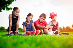 Cute children eating watermelon on a sunny day Royalty Free Stock Images