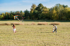 Cute children flying a kite Royalty Free Stock Photos