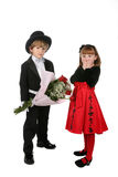 Cute children in formal clothes. Cute children in formal clothing; boy holding bouquet of red roses and girl looking surprised Royalty Free Stock Images