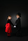 Cute children in formal clothes holding hands Stock Photography