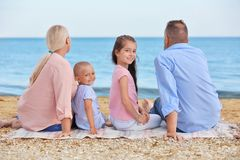 Cute children with grandparents. On sea beach Stock Images