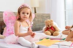 Cute children having fun in bedroom Royalty Free Stock Image