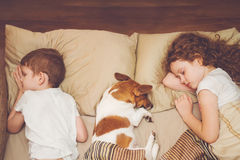Cute children and her puppy with sleep. Royalty Free Stock Photography