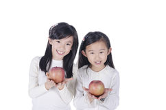 Cute children holds an apples Royalty Free Stock Photo