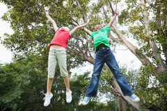 Cute children jumping up outside Royalty Free Stock Photo