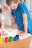 Cute children painting at kindergarten Stock Photo