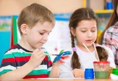Cute children painting at kindergarten Royalty Free Stock Photo