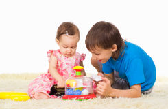 Cute children play Stock Photos