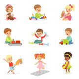 Cute Children Playing With Different Toys And Games Having Fun On Their Own Enjoying Childhood. Stock Photos