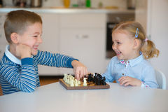 Cute children playing at home royalty free stock image