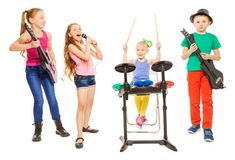 Cute children playing instruments and girl sings. Cute children playing on musical instruments together and girl singing as vocalist in front on white background Stock Photo
