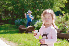 Cute Children are Playing in Park Stock Photo