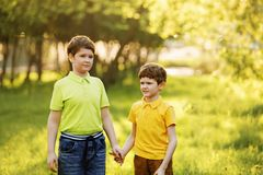 Cute children resting in summer park. stock photography