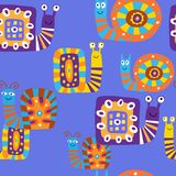 Cute children`s pattern with decorative snails on a blue backgro Stock Photos