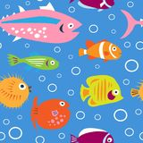 Cute children`s pattern with decorative tropical fish Stock Photography