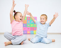 Children are sitting on floor Stock Photo