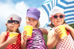 Cute children with soft drinks Stock Photo