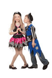 Cute children standing in costume of pirates for masquerade. Boy and girl in fun poses on white background . Children dressed as pirate Stock Images