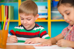 Cute children study at daycare Royalty Free Stock Photo