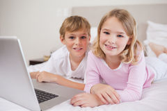 Cute children using a notebook Royalty Free Stock Image