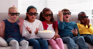 Cute children watching 3d movie on the sofa stock footage