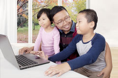 Cute children watching movies with their father Stock Image