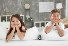 Cute children watching TV on sofa  at home Stock Photo