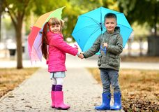 Free Cute Children With Umbrellas Stock Images - 105736814