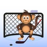 Cute chimpanzee playing ice hockey sport little monkey Royalty Free Stock Images